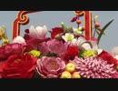 国慶節を祝う天安門広場の巨大花かごが観光客の注目を集める