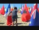 Child Running Through National Flags  荒谷竜太