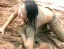 Thai girls playing in water and mud