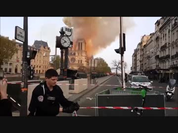Police and citizens in Paris during the fire of Notre Dame Cathedral