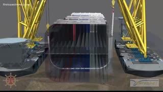 転覆した韓国の貨物船ゴールデンレイ号の周りに保護バリアを構築する
